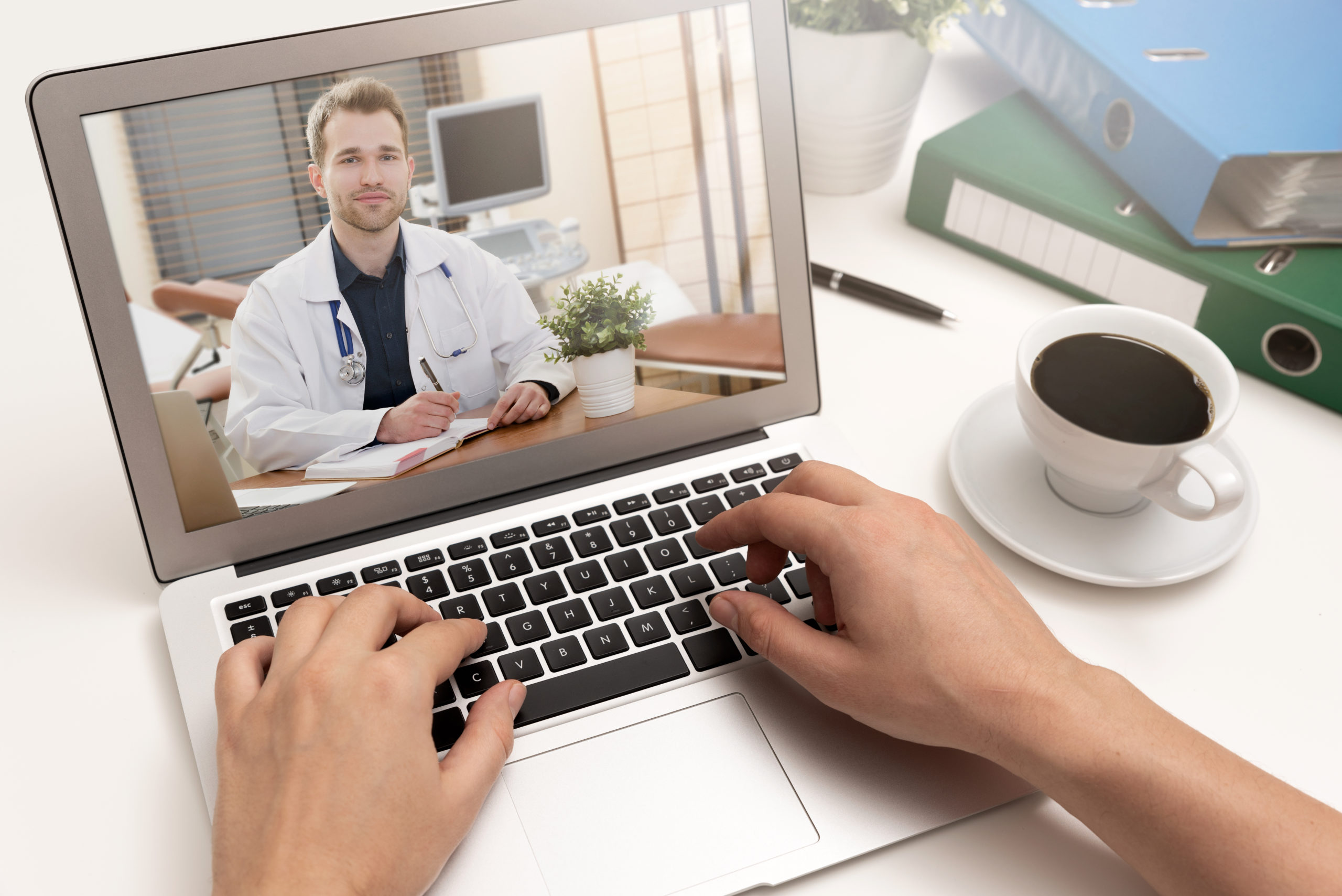 Doctor with a stethoscope on a laptop screen.